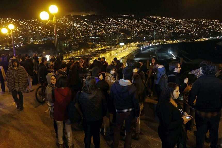 A group of people who left their houses in Valparaiso, Chile after a tsunami alert was issued for the 8.3-magnitude earthquake that hit the area on Sept 16, 2015.