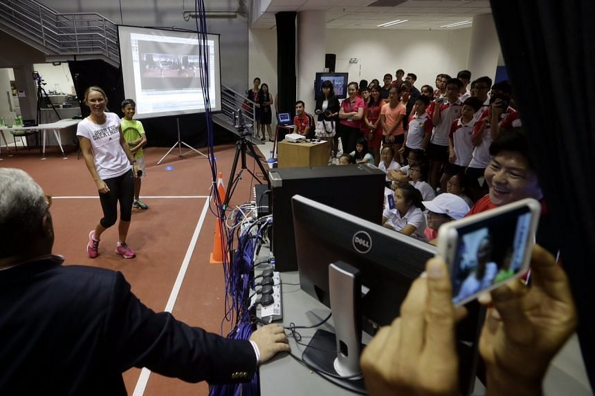 Caroline Wozniacki is in town for a meet and greet session with local tennis juniors and WTA Future Stars players at the Singapore Sports Institute.