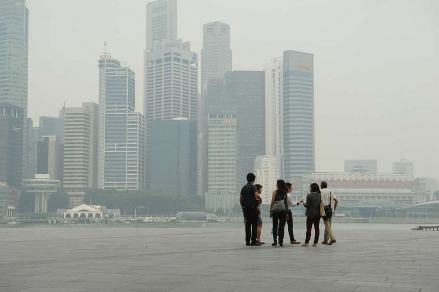 The skyline of central business district in Singapore obscured by haze on Sept 10, 2015.