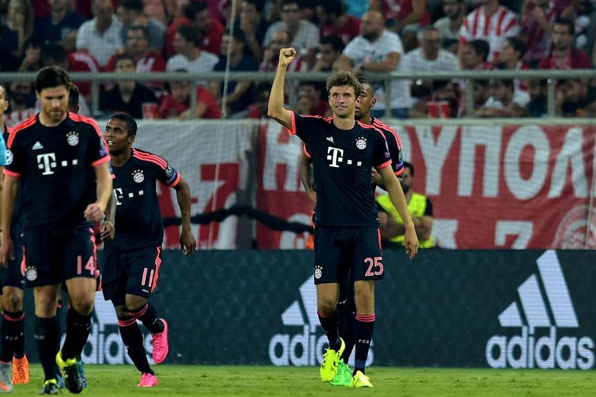Bayern Munich's German forward Thomas Mueller (right) celebrates after scoring against Olympiakos during their Champions League Group F football match.