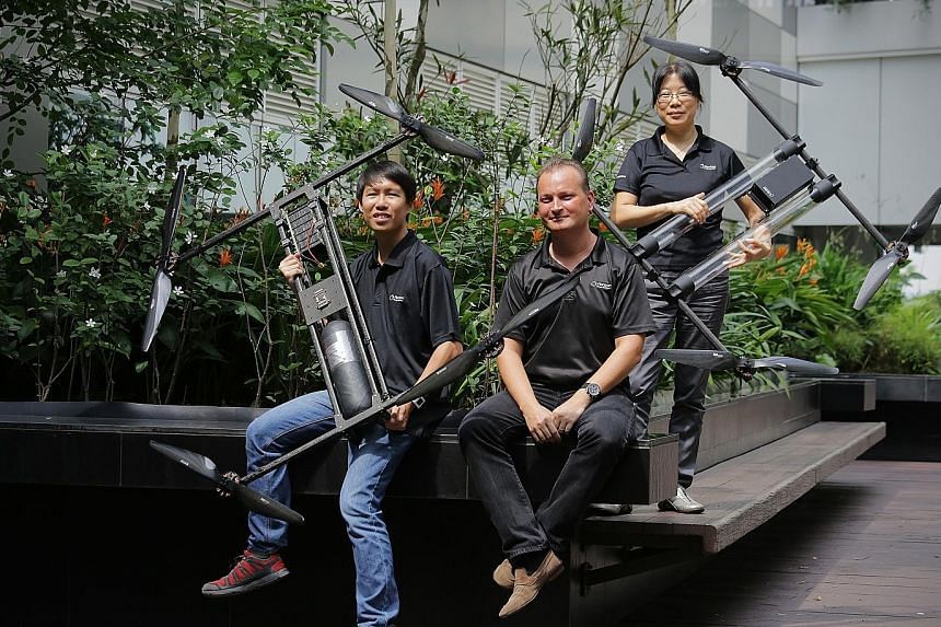 (From far left) Mr Yim Wai Tsyu, 25, drone operator, Mr Taras Wankewycz, CEO of Horizon Energy Systems, and Dr Li Aidan, senior research scientist, are involved in Horizon's development of a long-lasting fuel cell that is light and can power a drone