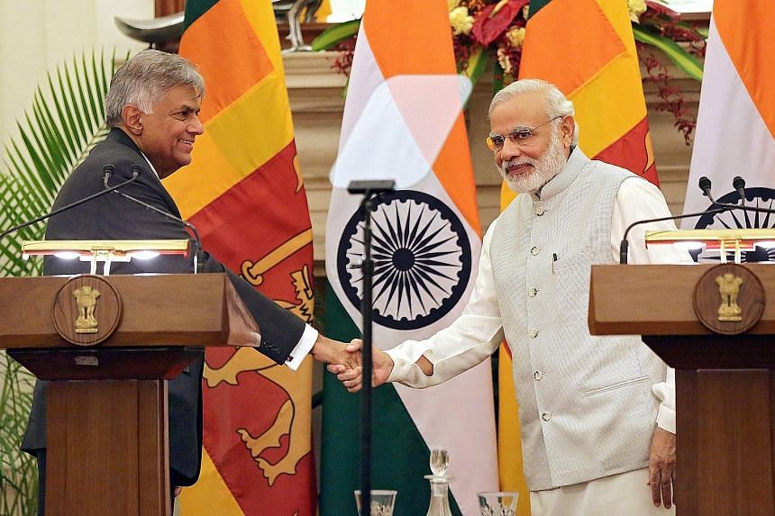 Sri Lankan Prime Minister Ranil Wickremesinghe (far left) and Indian Prime Minister Narendra Modi (left) during a joint press conference in New Delhi on Tuesday. Mr Wickremesinghe was on a three-day visit to India.