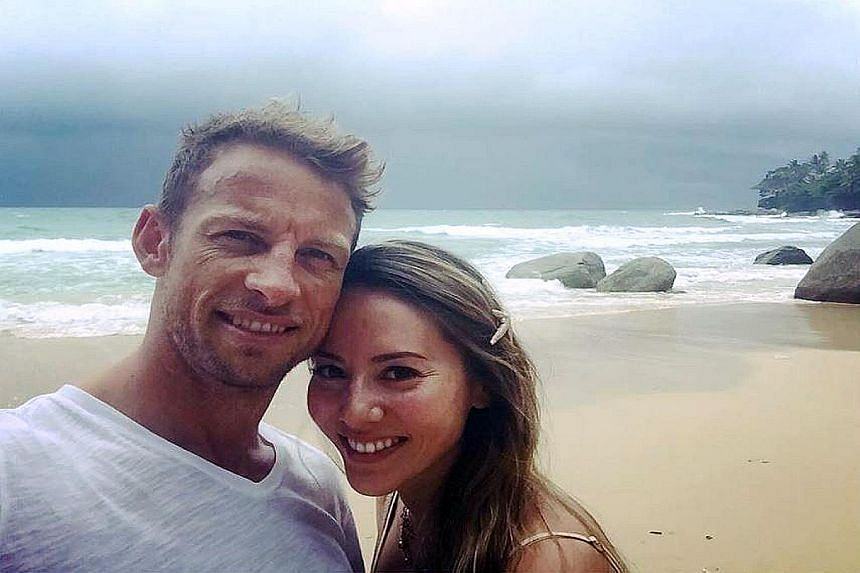 Button with his wife Jessica in Phuket, Thailand on Monday. Despite his relaxed air, he was there for rigorous endurance training sessions.