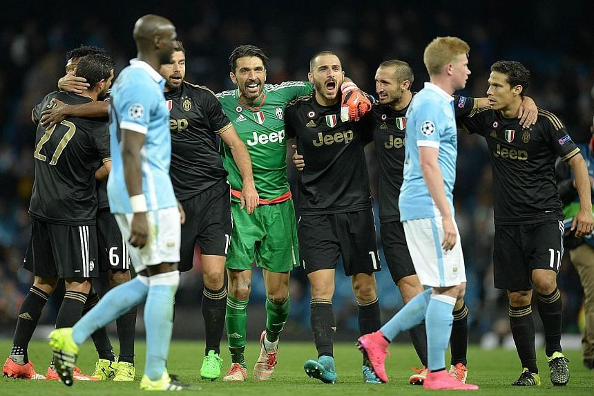 Juventus goalkeeper Gianluigi Buffon (centre), who had an outstanding match, celebrating with his team-mates after their victory over Manchester City.