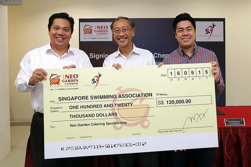 Neo Garden Catering CEO Neo (left) presenting the cheque to SSA president Lee (centre) and SSA executive director Edwin Ker yesterday. The money will boost the association's grassroots and other development programmes.
