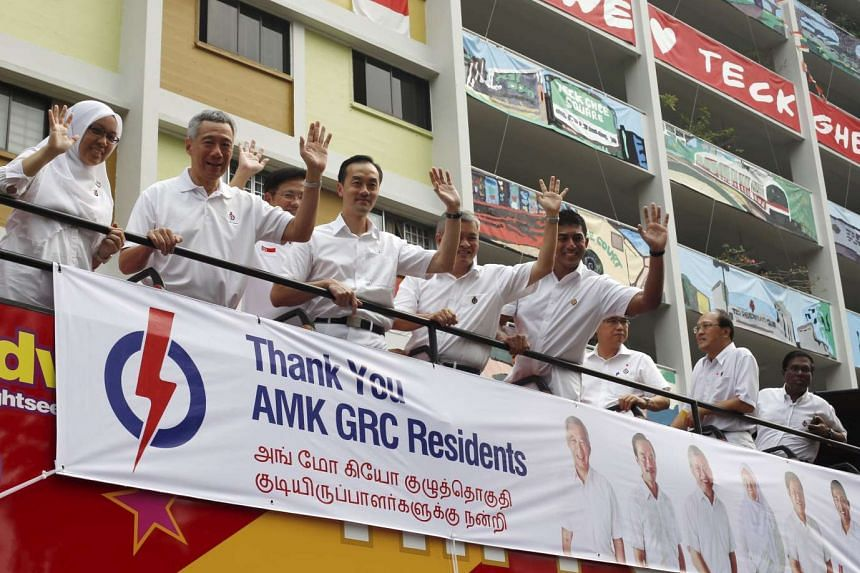 PM Lee Hsien Loong (second from left) and his team thank supporters after the general election on Sept 12, 2015.