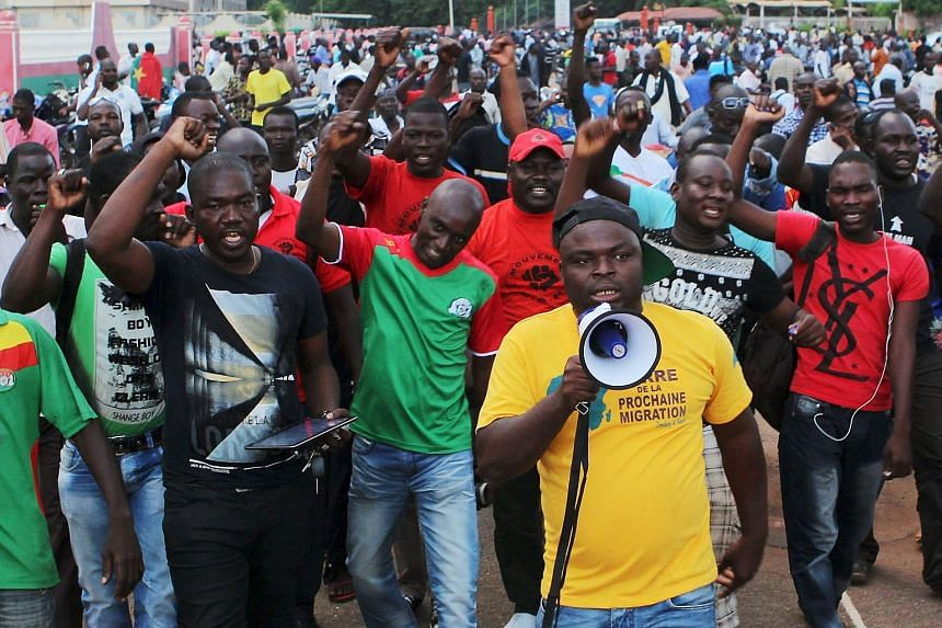 Protesters chant slogans against the presidential guard in Ouagadougou, Burkina Faso, on Sept 16, 2015.