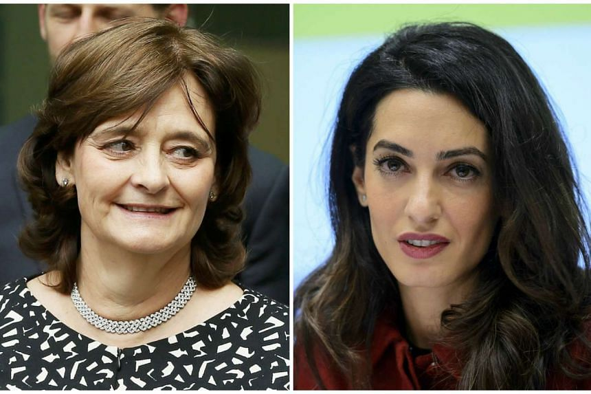 Cherie Blair (left) hit out at a call by fellow high-profile lawyer Amal Clooney (right) for sanctions against the island nation.