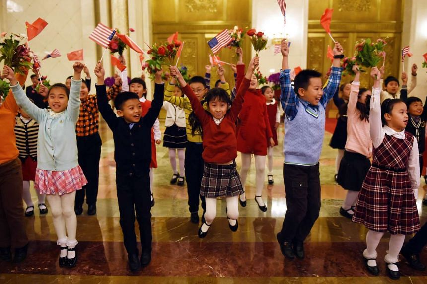 Children practicing before taking part in an official welcoming ceremony for US President Barack Obama during his visit to the Great Hall of the People in Beijing.