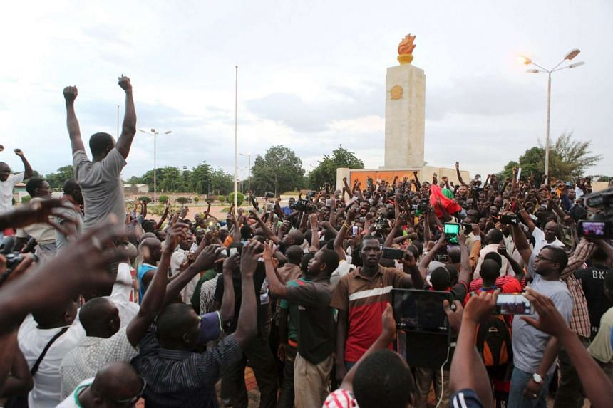 Protesters chant slogans against the presidential guard in Ouagadougou.
