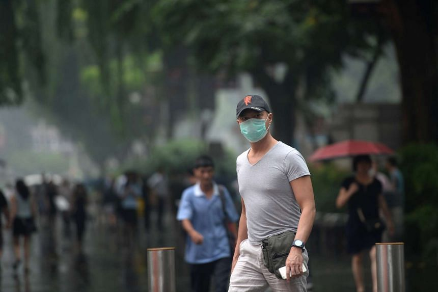 A man wearing a mask at Orchard Road on Sept 15, 2016. As of 9am on Thursday (Sept 17), the three-hour PSI, an indicative reading not tied to health advisory, was 62.