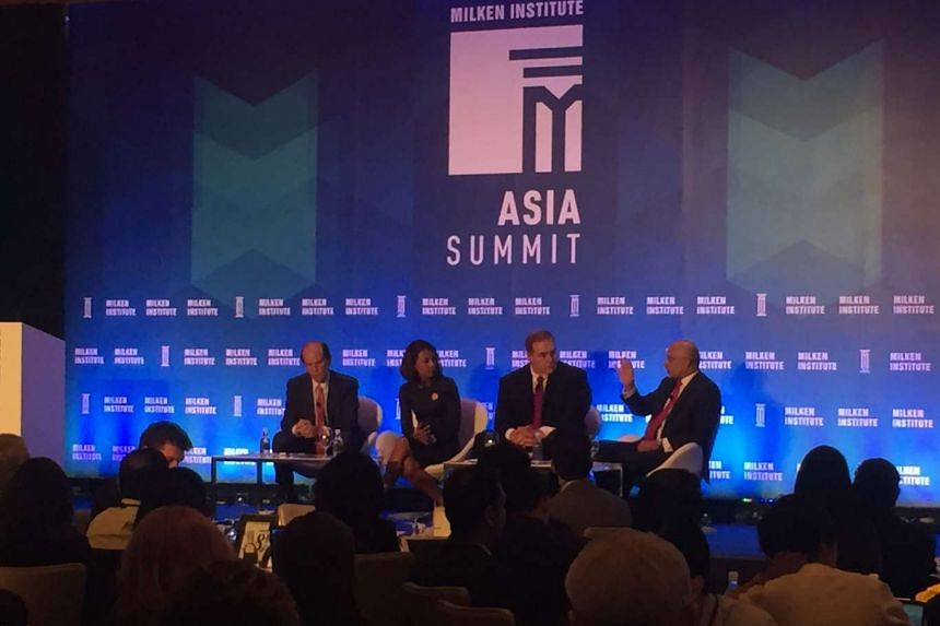 (From Left) Mr Michael Milken, chairman of Milken Institute, Ms Haslinda Amin, news correspondent of  Bloomberg Television, Mr Scott Minerd, global chief investment officer of Guggenheim Partners and Mr Piyush Gupta, chief executive of DBS Bank, at t