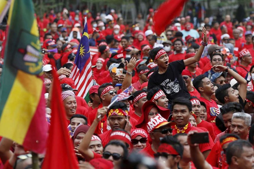 """Red Shirt"" demonstrators gather for a rally to celebrate Malaysia Day in Kuala Lumpur on Sept 16, 2015."