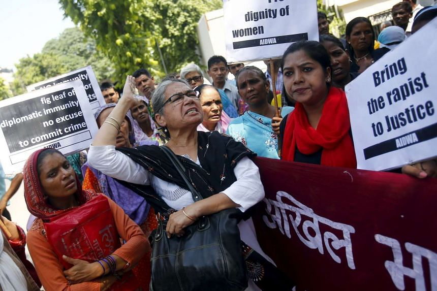 Demonstrators from the All India Democratic Women's Association shout slogans and hold placards during a protest outside Saudi Arabia's embassy in New Delhi on Sept 10, 2015.