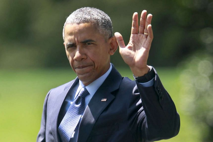US President Barack Obama waving as he walks from the Oval Office of the White House in Washington.