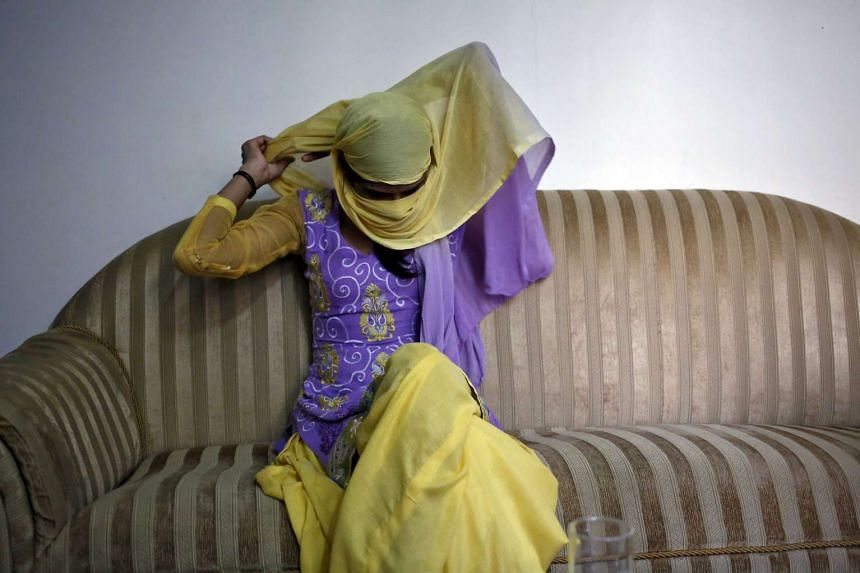 The 23-year-old sister waits at her lawyer's offices in New Delhi on Sept 1, 2015.