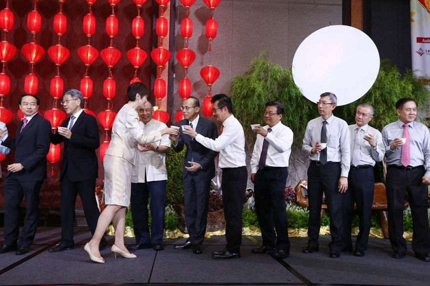 Mrs Josephine Teo, Senior Minister of State for Finance and Transport, clinks cups with Redas immediate past president Chia Boon Kuah (sixth from right) and Redas first vice-president Chia Ngiang Hong, at Redas' mid-autumn festival celebration yester