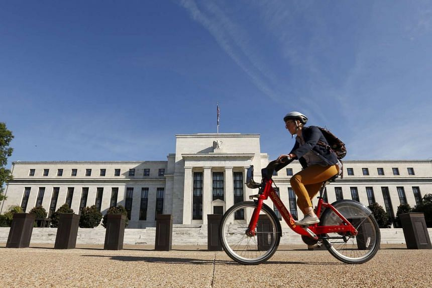 A cyclist passes the Federal Reserve headquarters in Washington on Sept 16, 2015.