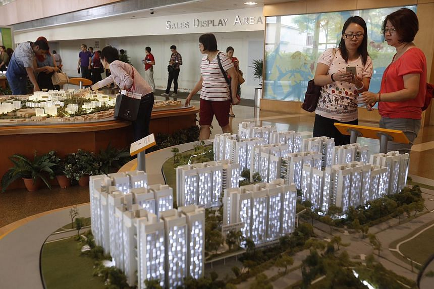 Members of the public viewing models of projects on sale at HDB Hub on Aug 24, 2015.