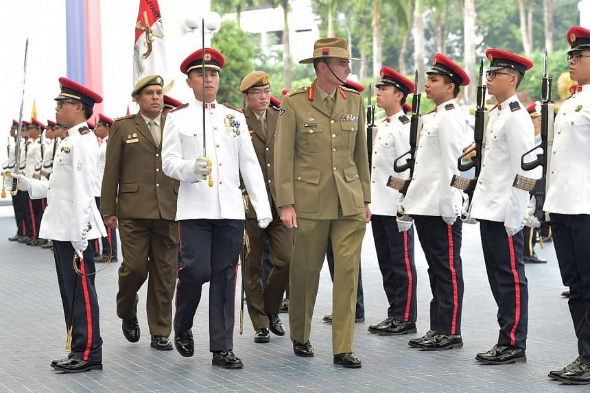Lt-Gen Campbell inspecting the Guard of Honour at Mindef.
