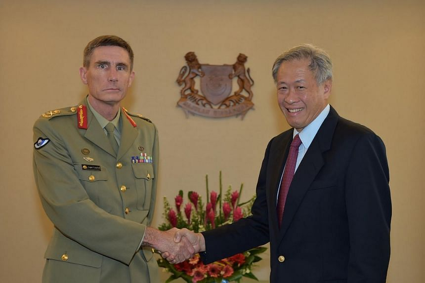 The Chief of Army of the Australian Defence Force Lieutenant General (Lt-Gen) Angus Campbell (left) calling on Minister for Defence Dr Ng Eng Hen at the Ministry of Defence.