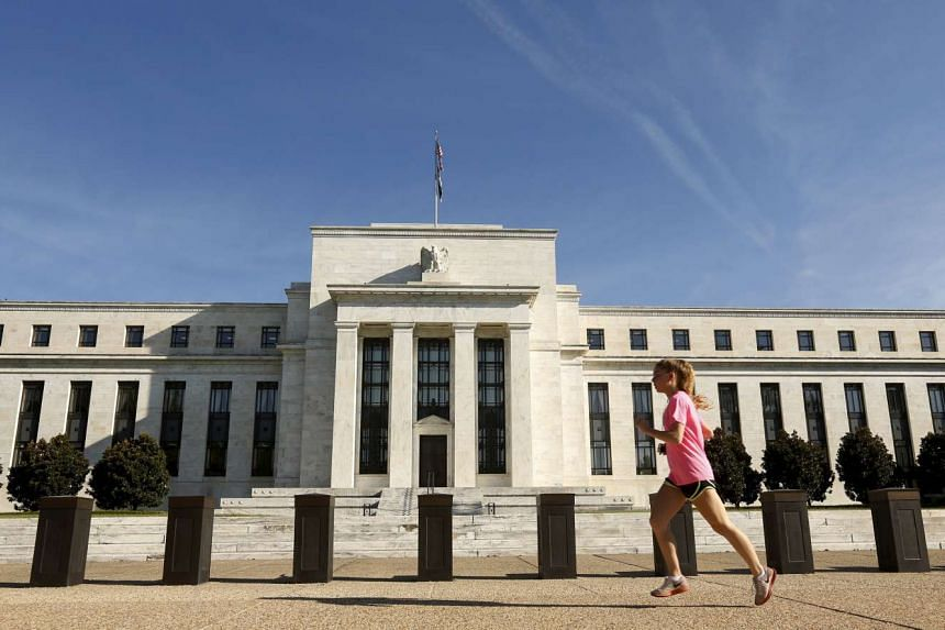 A woman jogs past the Federal Reserve headquarters in Washington.
