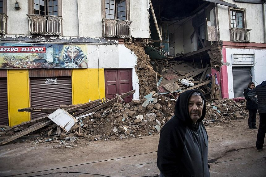 One of the homes in Illapel, 200km north of Santiago, destroyed in the earthquake. Most buildings in Illapel had stayed standing. Quake-prone Chile has strict building regulations that limit potential damage. Yesterday, dozens of strong aftershocks c