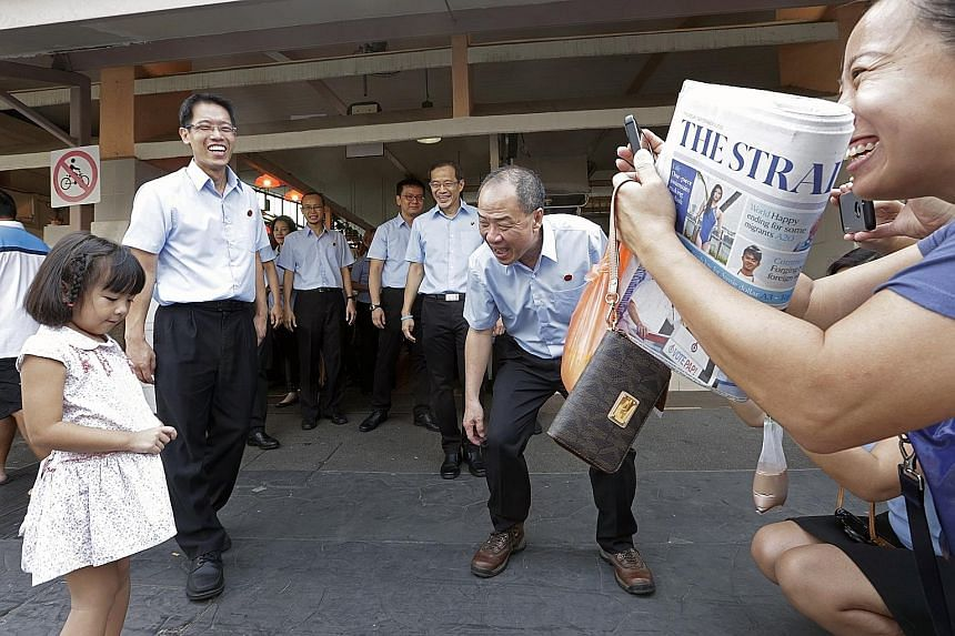 Party leaders - (from left photo) People's Action Party's Ng Eng Hen, Workers' Party's Low Thia Khiang and Singapore Democratic Party's Chee Soon Juan (in khaki shirt) - and supporters of all stripes turned to The Straits Times for the latest news on