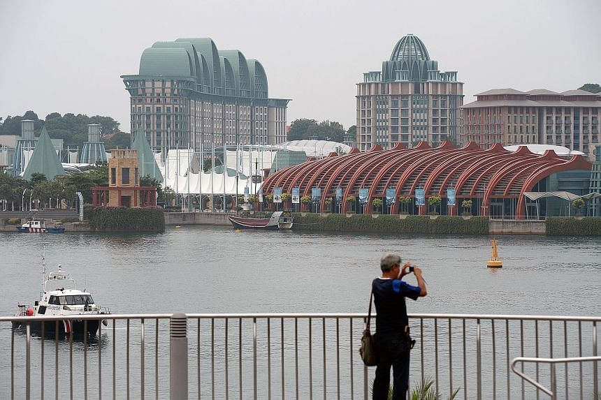 A view of Resorts World Sentosa seen from VivoCity yesterday - a less hazy day. Last Saturday night, the 24-hour PSI moved into the unhealthy range, easing into moderate levels only at 10am yesterday.