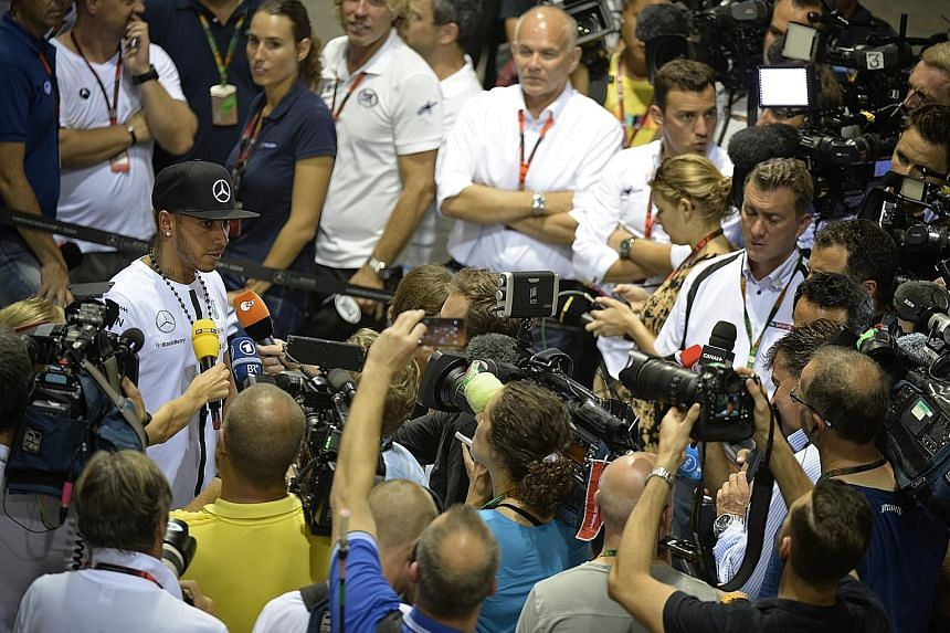 Ahead of this weekend's Formula One Singapore Airlines Singapore Grand Prix at the Marina Bay Street Circuit, the F1 drivers spent yesterday entertaining both their fans as well as the media. Mercedes GP driver Lewis Hamilton (with black cap) was sur