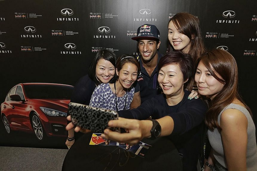 "Red Bull driver Daniel Ricciardo with fans during an Infiniti event at Paragon yesterday. He said Mercedes are ""just too strong"" but feels Red Bull can ""definitely get close"" to Ferrari."