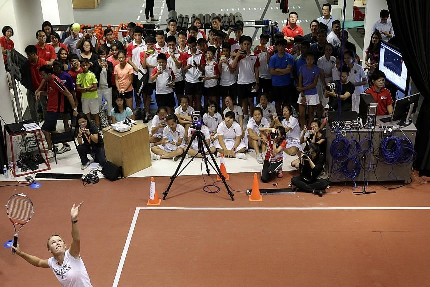 Besides serving up tips at the Singapore Sports Institute, Caroline Wozniacki also dissected what went right and wrong in her serves that were captured on video.