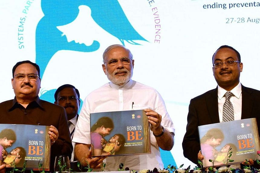 "India Prime Minister Narendra Modi (centre), Indian Health Minsiter Jagat Prakash Nadda (left) and Ethopian Health Minister Kesetebirhan Admasu posing for a photograph during the ""Call To Action Summit"" in New Delhi on Aug 27, 2015. The summit is a g"