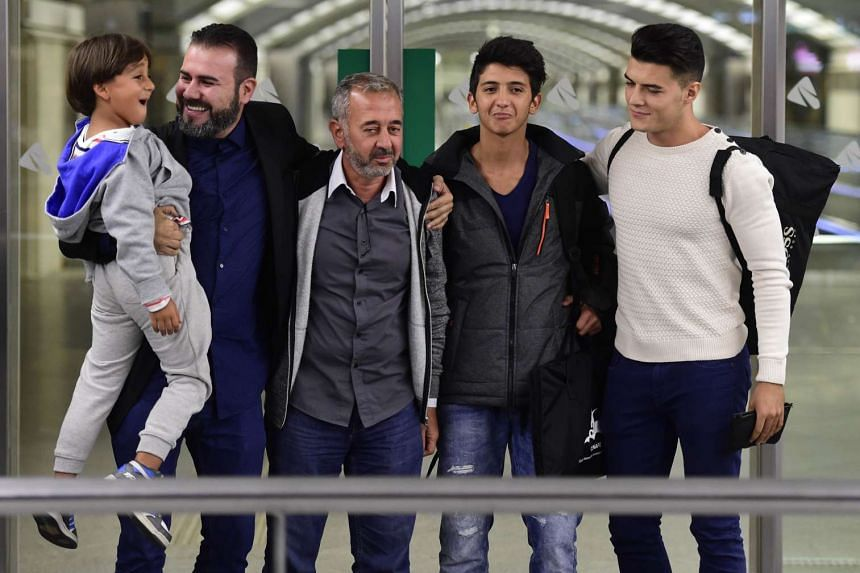 Mohsen (third right) with sons Zaid (left) and Mohamed (second right) and two Cenafe representatives at Atocha train station in Madrid.