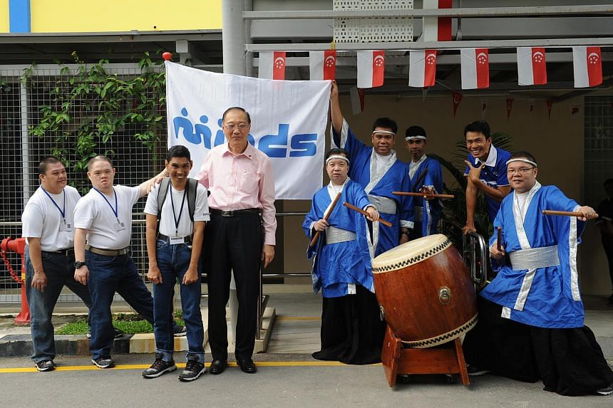 Mr Jeffrey Tan (centre), President of The Movement for the Intellectually Disabled of Singapore (MINDS) at the opening of the dedicated Caregivers Support Services Centre at Jalan Ubi.