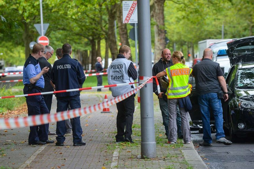 Police secure evidence after an Iraqi man was shot dead by officers on Sept 17, 2015 in Berlin.