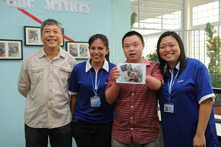 Mr Liew Chong Pow (far left) with his son Jonathan and Minds staff (from left) Ms Joie Aludino and Ms Koh Chu Wen at the group's new facility at Kembangan-Chai Chee Community Hub.