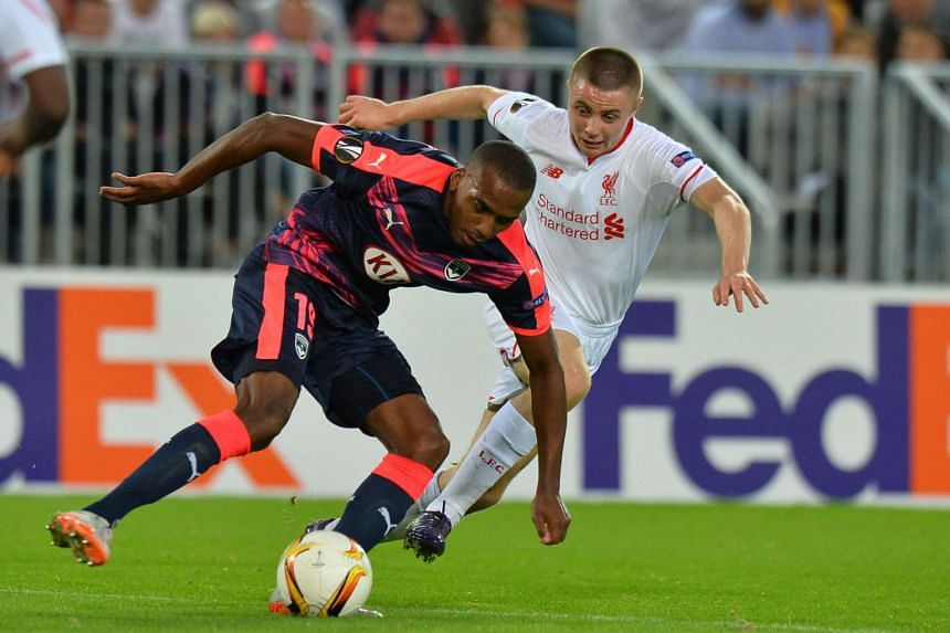 Liverpool midfielder Jordan Rossiter (right) vies with Bordeaux's midfielder Nicolas Maurice-Belay.