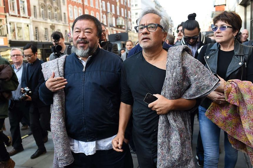 Chinese artist Ai Weiwei (left) walks with British-Indian artist Anish Kapoor (right) during a solidarity for refugees walk through London.