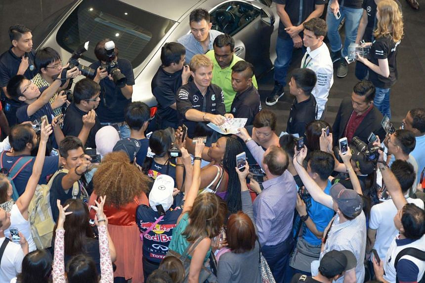 Mercedes driver Nico Rosberg of Germany meeting his fans at Suntec City on Sept 17, 2015.