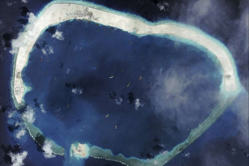 China's apparent construction of an airstrip on Mischief Reef (above), together with two others on other islands, could form a rough triangle in the heart of the Spratlys.