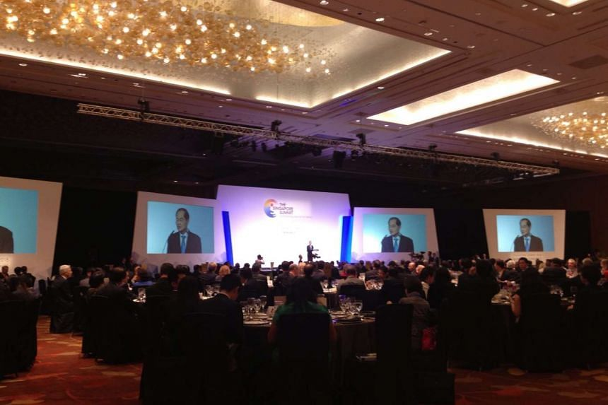Minister for Trade and Industry Lim Hng Kiang addresses delegates at the Singapore Summit on Friday. PHOTO: MARISSA LEE