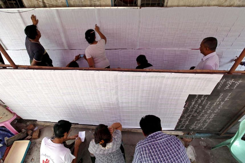 People check their names on the voters' list in Kamayut township, Yangon.