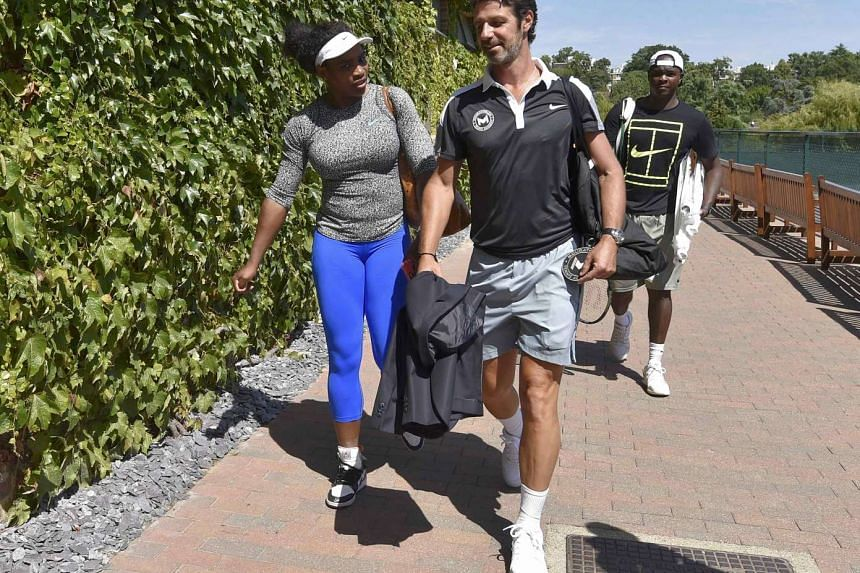 Serena Williams leaving the practice courts with coach Patrick Mouratoglou after a practice session at the Wimbledon Tennis Championships.