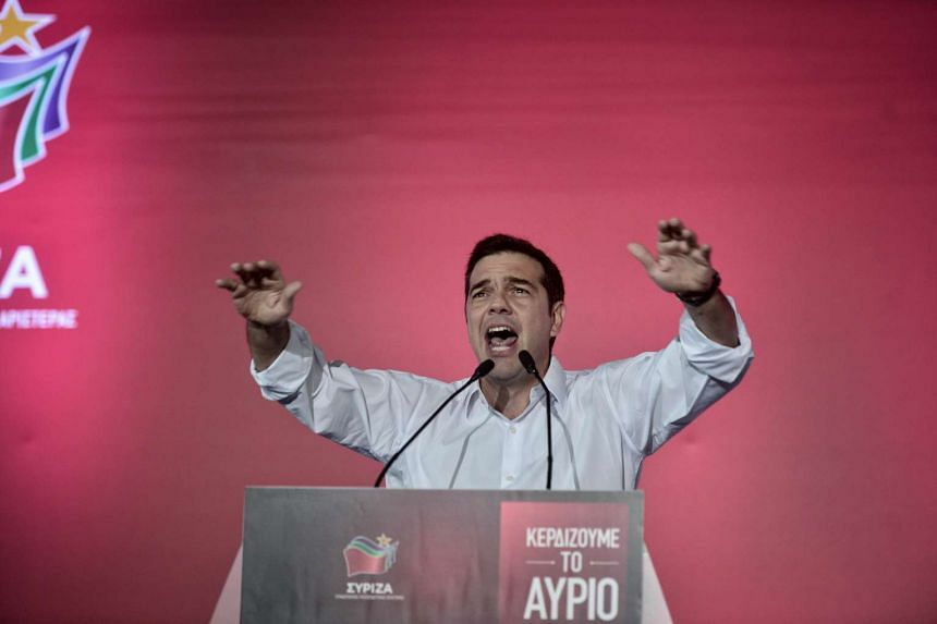 Former Greek Prime Minister Alexis Tsipras speaking at his party's main pre-election rally in central Athens on Sept 18, 2015.