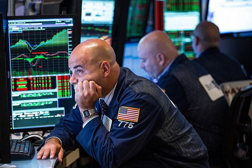 "Traders on the floor of the New York Stock Exchange after the Federal Reserve chose not to raise interest rates. The Fed said the slump in equities in the past month ""may restrain economic activity"", which could put ""downward pressure on inflation in"