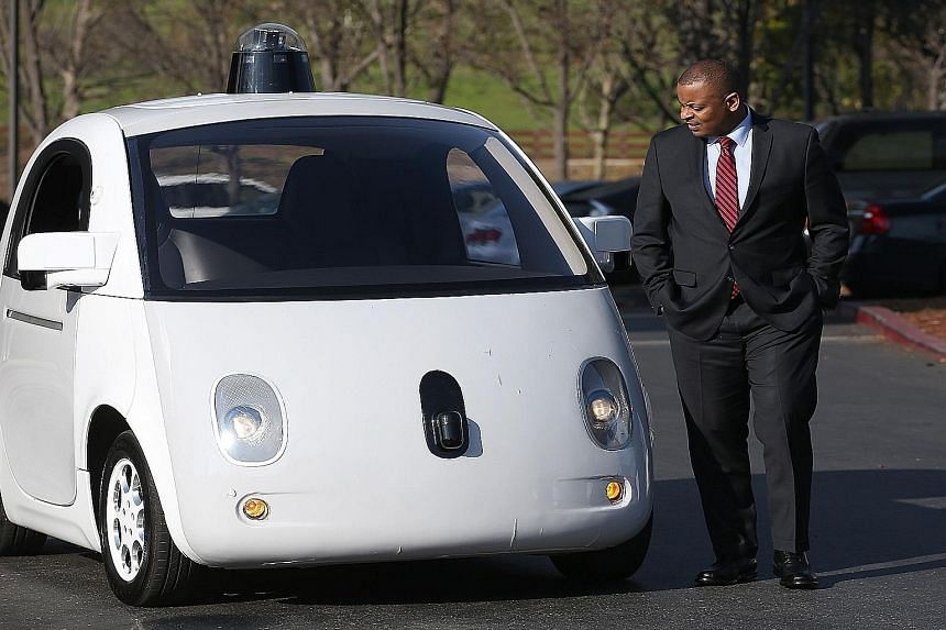 Mr John Krafcik (above) now heads Google's self-driving car division. The car being inspected by United States Transportation Secretary Anthony Foxx (top) earlier this year.