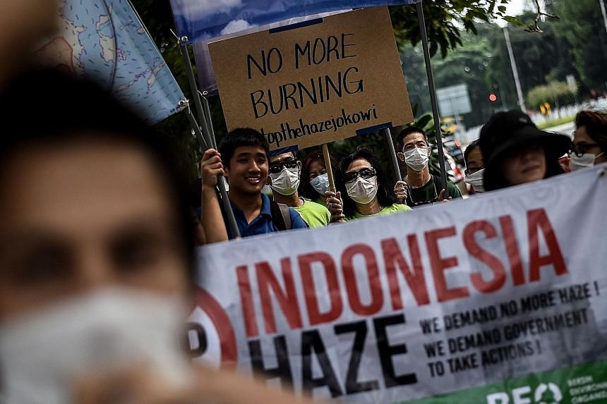 Protesters demonstrating outside the Indonesian Embassy in Kuala Lumpur yesterday over the prevailing haze conditions. Haze from forest and peatland fires in Indonesia over the past weeks has spread to Singapore and Malaysia, with the bad air making