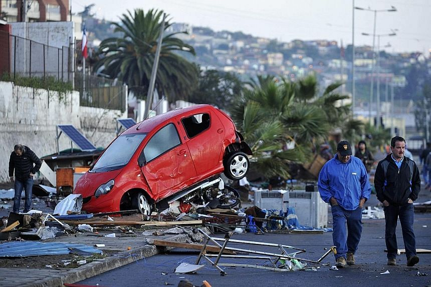A car wrecked by strong waves which slammed into the shore during Wednesday's earthquake in Coquimbo port city. The magnitude-8.3 quake was the world's strongest this year and the biggest to hit Chile since 2010. One million people were forced to eva