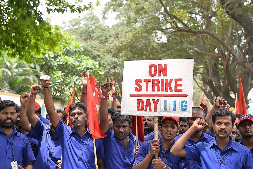 Trade union activists protesting against the central government's economic policies in Bangalore at a rally on Sept 2. The dearth of jobs for the country's growing workforce is a challenge for Prime Minister Narendra Modi.